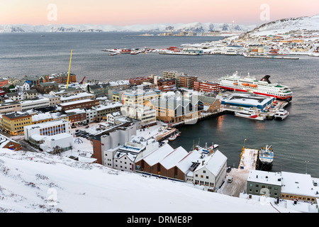 Hammerfest, Norway, the northernmost town in the world, with cruise ship Nordnorge in port and natural gas plant - Stock Photo