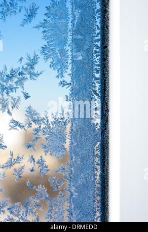 Winter patterns on window glass - Stock Photo
