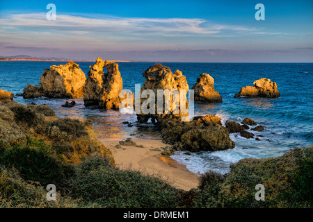 Portugal, the Algarve  rock formations on a small beach near Albufeira in evening light - Stock Photo