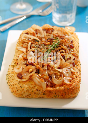 Focaccia with caramelized onions. Recipe available. - Stock Photo