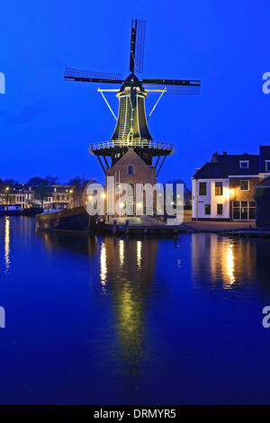 Windmill and Spaarne River at twilight, Haarlem, Netherlands - Stock Photo