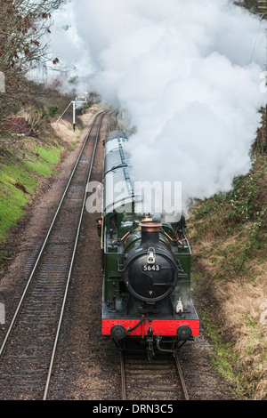Looking down onto Great Western Railway 0-6-2T steam loco heading a passenger train on the Great Central Railway - Stock Photo