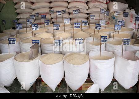 Sacks of Rice for Sale in Vietnam - Stock Photo
