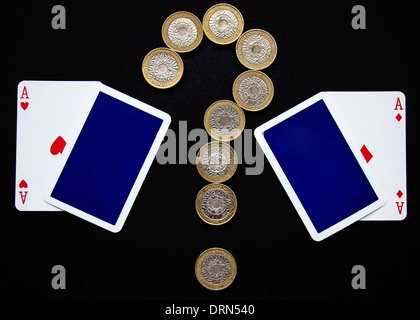 Cards with Coins in Question Mark shape - Stock Photo