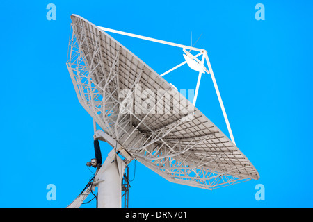 Big satellite dish. Ground earth terrestrial station for television communication telecommunications networks link - Stock Photo