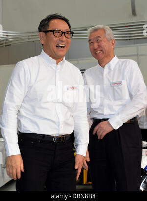 Tokyo, Japan. 30th Jan, 2014. President Akio Toyoda, left, of Japan's Toyota Motor Corp., shares a laugh with its - Stock Photo