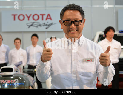 Tokyo, Japan. 30th Jan, 2014. President Akio Toyoda of Japan's Toyota Motor Corp., flashes the thumbs-up sign during - Stock Photo