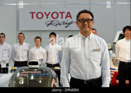 Tokyo, Japan. 30th Jan, 2014. President Akio Toyoda of Japan's Toyota Motor Corp., poses with drivers and staff - Stock Photo