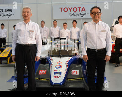 Tokyo, Japan. 30th Jan, 2014. President Akio Toyoda, front right, of Japan's Toyota Motor Corp., poses with drivers - Stock Photo