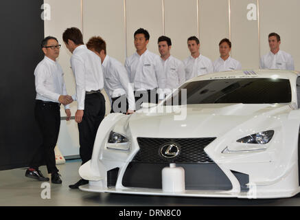 Tokyo, Japan. 30th Jan, 2014. President Akio Toyoda of Japan's Toyota Motor Corp., shakes hands with drivers of - Stock Photo