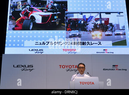 Tokyo, Japan. 30th Jan, 2014. President Akio Toyoda of Japan's Toyota Motor Corp., takes off his business suit for - Stock Photo