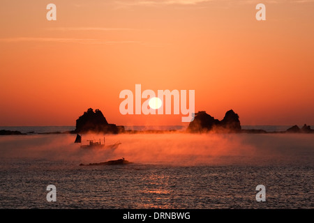 The Sunraise and steam mist in Kumano Nada. - Stock Photo