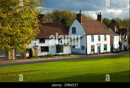 Tudor houses beside the village green in Cavendish, Suffolk, England. - Stock Photo