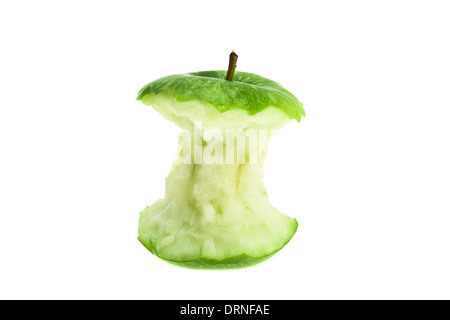 An eaten green apple core - studio shot with a white background - Stock Photo
