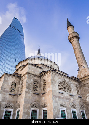 The Mosque of the Martyrs (Sehidler Mescidi Mosque, Turkish Mosque) with the Flame Towers skyscraper in the background - Stock Photo