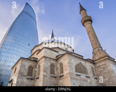 The Mosque of the Martyrs (Sehidler Mescidi Mosque, Turkish Mosque) with the Flame Towers in the background in Baku, - Stock Photo
