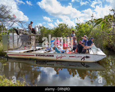 Florida Everglades National Park, USA - Group of tourists on an Airboat sightseeing ride boat tour trip in summer - Stock Photo