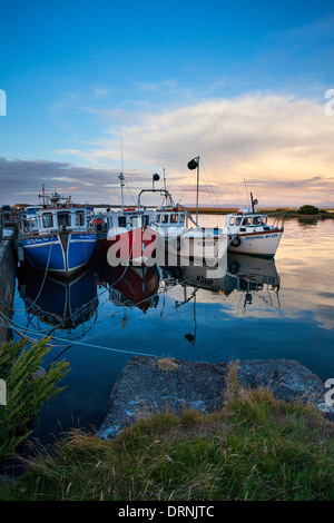 Evening fishing boats moored beside Killala pier, County Mayo, Ireland. - Stock Photo