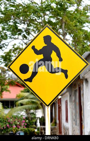road sign caution soccer player Panama city Panama - Stock Photo