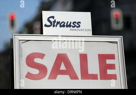 Duesseldorf, Germany. 30th Jan, 2013. The Strauss Innovation logo is seen above a sale sign in a store in Duesseldorf, - Stock Photo