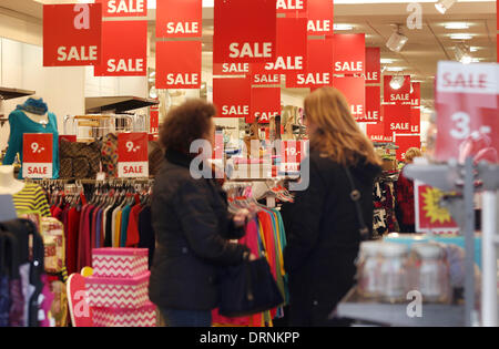 Duesseldorf, Germany. 30th Jan, 2013. Sale signs hang in a Strauss Innovation store in Duesseldorf, Germany, 30 - Stock Photo