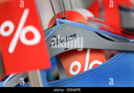 Duesseldorf, Germany. 30th Jan, 2013. The Strauss Innovation logo is seen on a hanger next to sale signs in a store - Stock Photo