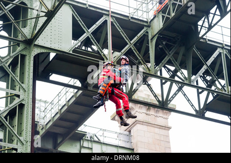 Local fire fighters have a high angle rescue exercise at the old ship canal lift Henrichenburg. - Stock Photo
