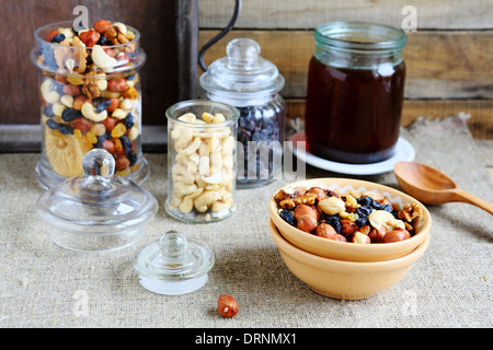 nuts and honey in jars, food closeup - Stock Photo