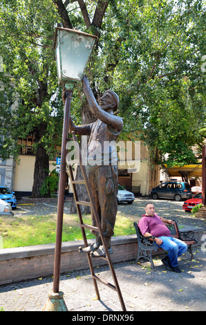 Statue of lamplighter cleaning an old gas lantern, Tbilisi, Georgia - Aug 2013 - Stock Photo