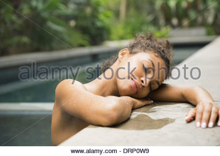 Relaxed woman in swimming pool - Stock Photo
