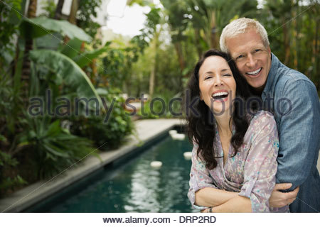 Portrait of affectionate couple embracing outdoors - Stock Photo