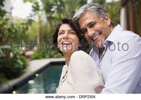 Mature couple embracing outdoors - Stock Photo