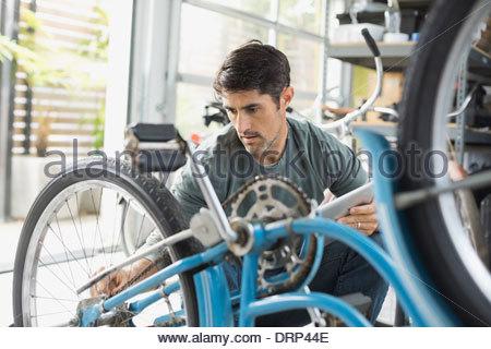 Man repairing bicycle chain - Stock Photo