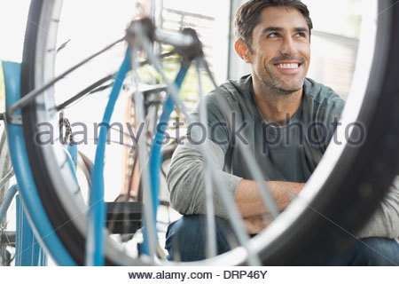 Man in bicycle shop - Stock Photo