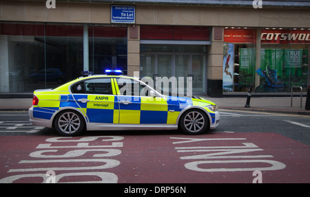Interceptor on the Move_ Greater Manchester Police ANPR Intercept Team vehicle in Deansgate, Manchester, UK, Europe, - Stock Photo