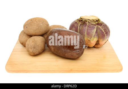 Haggis tatties and neeps on a wooden board isolated against white - Stock Photo