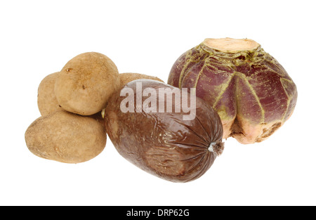 Ingredients for a traditional Scottish Burns night meal,haggis,neaps and tatties isolated against white - Stock Photo