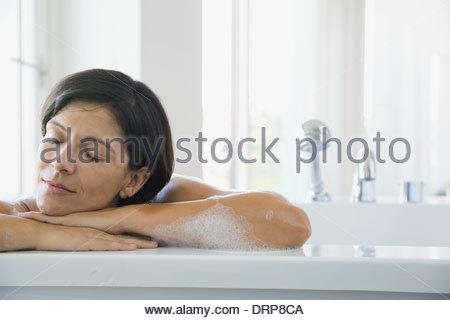 Woman relaxing in bubble bath - Stock Photo