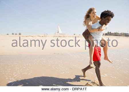 Couple spending time at the beach - Stock Photo