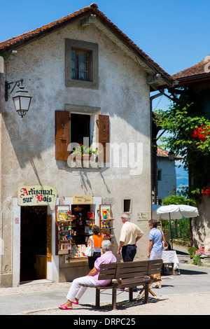 Tourists shopping for souvenirs in the old medieval district of Yvoire by Lac Leman, Lake Geneva, France - Stock Photo