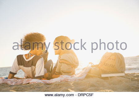 Couple spending leisure time at beach - Stock Photo