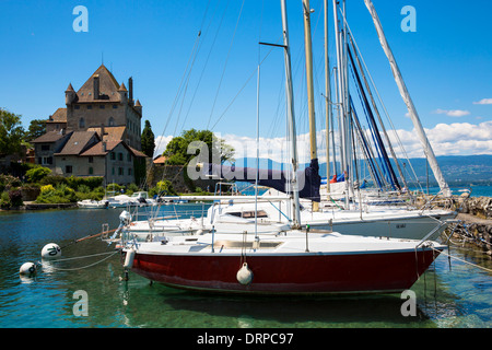 Yachts by the 12th Century medieval castle in the old port of Yvoire on Lac Leman, Lake Geneva, France - Stock Photo