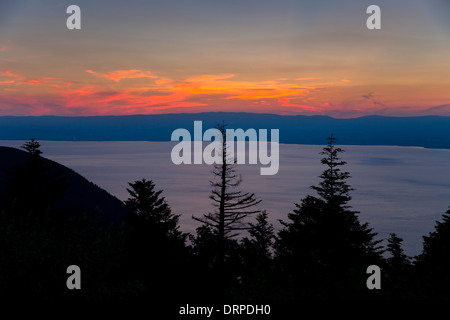 Sunset over Lac Leman, Lake Geneva, France looking towards Switzerland - Stock Photo