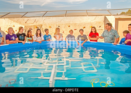 Multiracial middle school students in Mission Viejo, CA, test the remote operated submarine vehicles (ROV) they - Stock Photo
