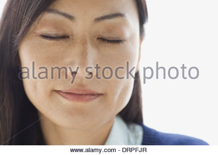 Close-up portrait of relaxed woman - Stock Photo