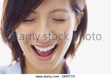 Close-up of woman laughing - Stock Photo