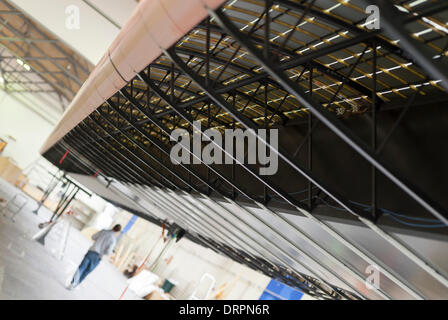 Duebendorf, Switzerland. , 29 Jan 2014: An unfinished part of the huge 72m solar cell-covered carbon fibre wing - Stock Photo
