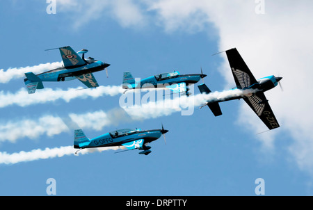 The blades aerobatic display team in close formation at Farnborough International Airshow 2012 - Stock Photo