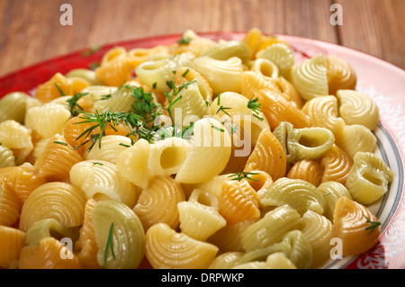 closeup of Colorful Italian conchiglie gourmet pasta - Stock Photo