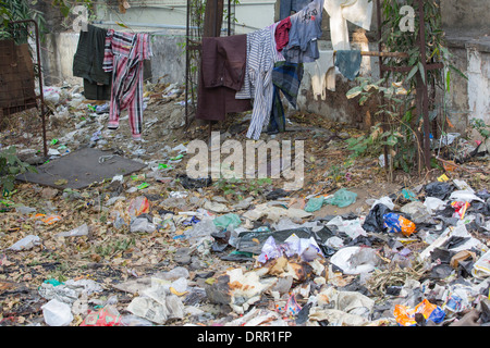 Slum housing and garbage in Ahmedabad; India; - Stock Photo